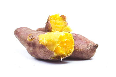 Sweet potatoes on white background Imagens