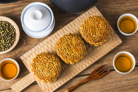The popular mid-autumn festival is celebrated by Chinese all over the world  Mooncake Festival  Usually after reunion dinner,mooncake are served with hot Chinese tea and children playing lanterns Stock Photo