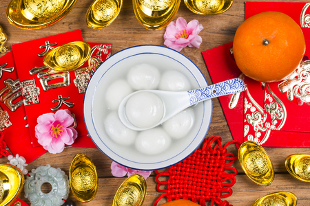 Chinese Lantern Festival food,ang pow or red packet and gold ingots. Chinese characters means luck,wealth and prosperity.