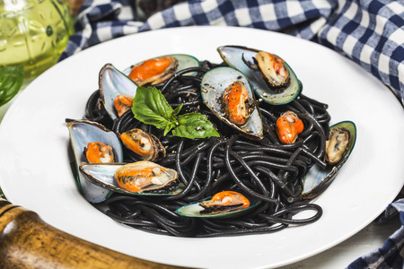Black spaghetti. Black seafood pasta with mussels  . Mediterranean delicacy food. Stock Photo