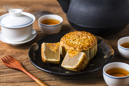 Mid Autumn Festival Chinese Traditional Pastry Mooncake. The Chinese character on the mooncake represent