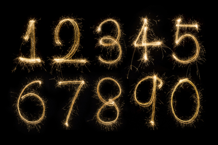 Numbers sparklers on black background