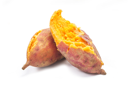 Baked sweet potatoes on white background
