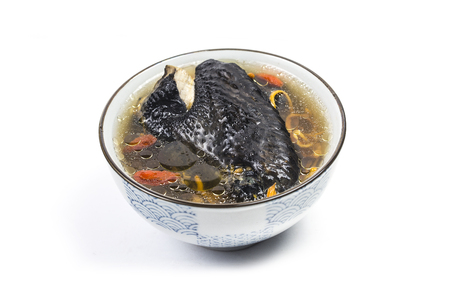 Herbal black bone chicken soup Stock Photo