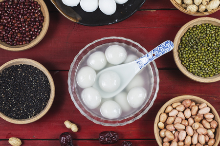 Tangyuan in bowl and various legume ingredients for tang yuan filling