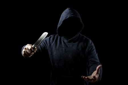 Bandit with knife on dark background
