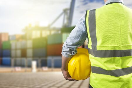 Rear view of dock worker with container logistic freight background Standard-Bild - 124857307