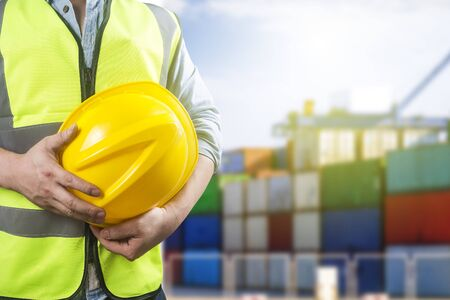 Mid section of dock worker with container logistic freight background Standard-Bild - 124857730