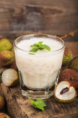 Fresh made Lychee Juice on wooden background Reklamní fotografie