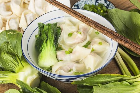 Chinese wonton dumpling in clear soup Фото со стока