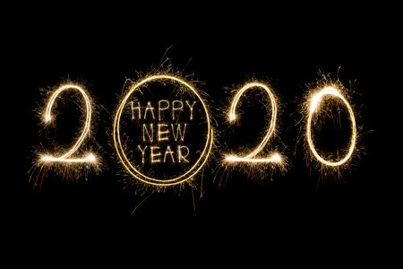 Happy New Year 2020. Creative text Happy New Year 2020 written sparkling sparklers isolated on black background