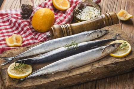 Saury fish on wooden board