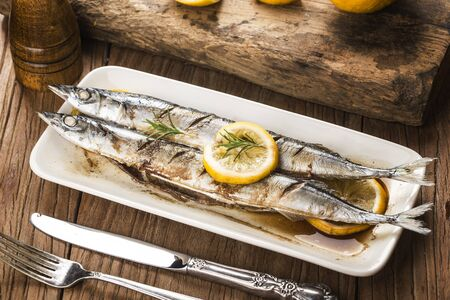 a plate of fresh barbecue saury Stockfoto