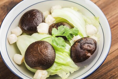Vegetables, mushroom and scallop soup