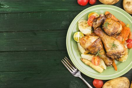 Grilled chicken leg with boiled potatoes and vegetable
