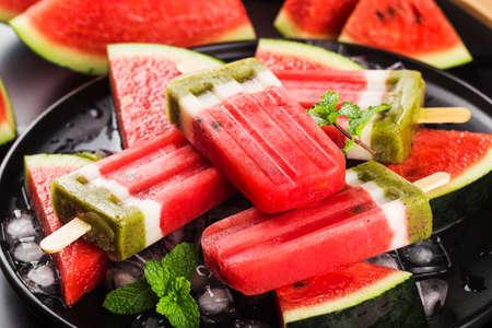 Homemade watermelon ice cream stick on a plate. Summer food concept. Reklamní fotografie
