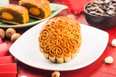 Mid-Autumn Festival concept. Traditional mooncakes on table with teacup.