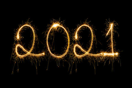 Happy New Year 2021. Sparkling burning text Happy New Year 2021 isolated on black background.