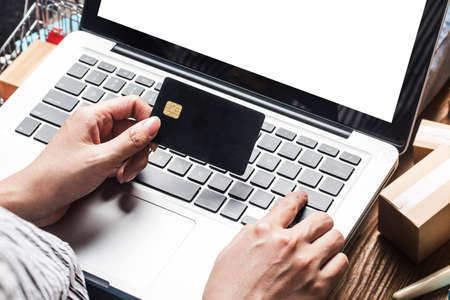 A woman is using a computer to shop online