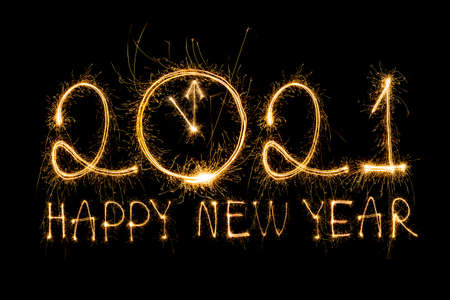 Happy New Year 2021. Sparkling burning text Happy New Year 2021 isolated on black background.New year countdown 写真素材