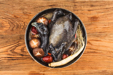 Ginsengs and black chicken soup,  food as medicine. 写真素材 - 161935873