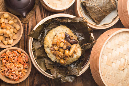 Steamed chicken with lotus leaf sticky rice