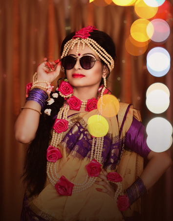 Indian wedding. Morning preparations . Portrait of attractive Hindu bride wearing sunglass
