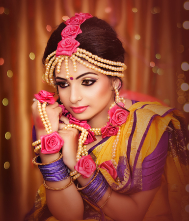 Indian wedding. Morning preparations . Portrait of attractive Hindu bride with deep dark eyes