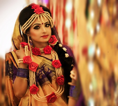 Indian wedding. Morning preparations . Portrait of attractive Hindu bride with deep dark eyes