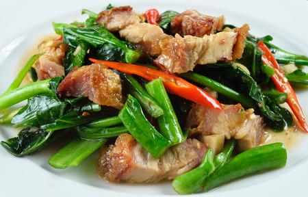 fried chinese broccoli   with crispy pork