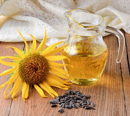 sunflower oil: Sunflower oil with sunflower  on wooden background.