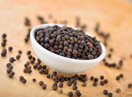 black peppercorn: Black peppercorn on wooden background