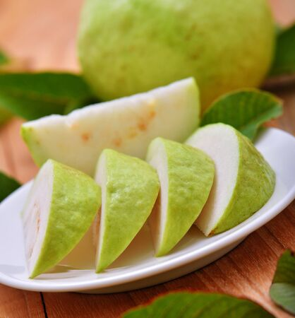 guava fruit: Fresh guava fruit on wooden background
