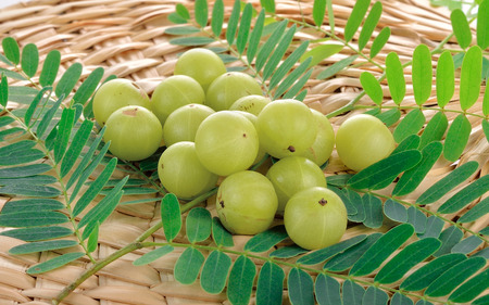 sour food: Indian gooseberries on white background