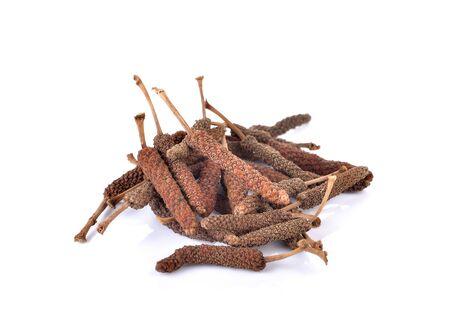 myrobalan: Pile of Dried Organic Long pepper on white background