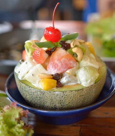 fruity salad: healthy fruit salad in melon bowl