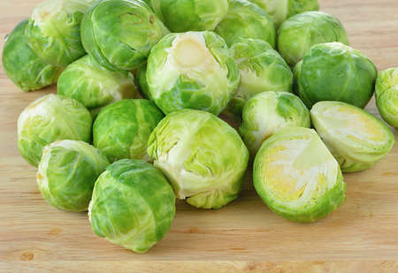 brussel: Brussel Sprouts isolated on wooden  background