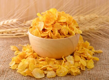 Cornflakes cereal on wooden background
