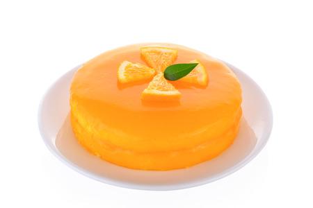 Homemade orange cake on white background