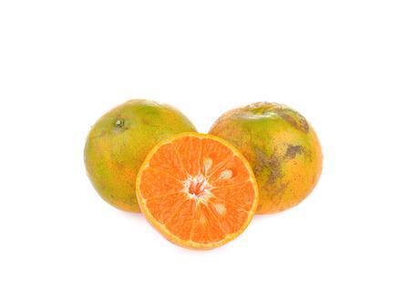 Organic orange fruit on white background