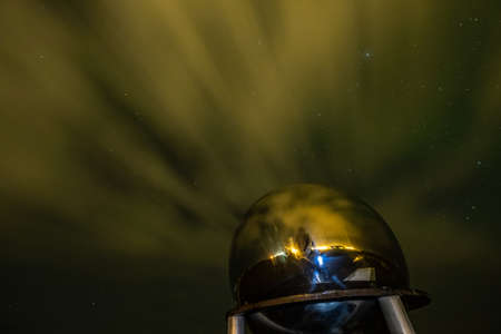 Aurora Borealis or better known as the The Northern Light, with a golden ball in the foreground, Iceland
