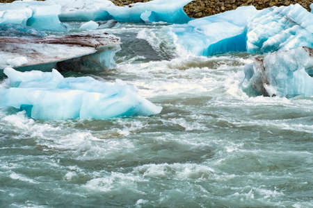 Icebergs floating in the cold water of the Jokulsarlon glacial lagoon. Vatnajokull National Park, in the southeast Iceland during a road trip
