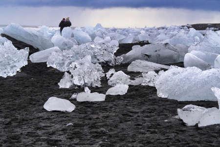 Ice rock with black sand beach at Jokulsarlon beach, Diamond beach in southeast Iceland