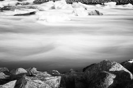 Jokulsarlon glacier lagoon in Iceland. Long exposure shot makes the water and the sky silky. Long exposure, glacier, moody concepts. vintage black and white.