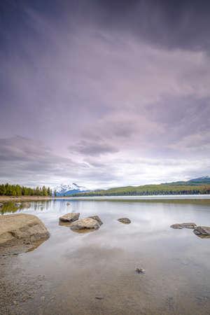 Beautiful view of frozen Maligne Lake in Jasper National Park