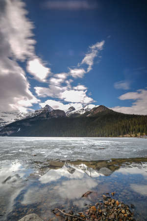 Mount fairview, partly frozen lake, Lake Louise Banff National Park, Alberta Canada