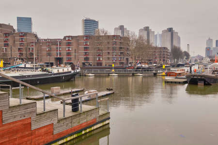 Rotterdam - 13 February 2019: Rotterdam, The Netherlands. View of the Leuvehaven ship harbor in the city center of Rotterdam . It is located in the center of Rotterdam near the Erasmus bridge, South Holland, Rotterdam, Netherlands Editorial