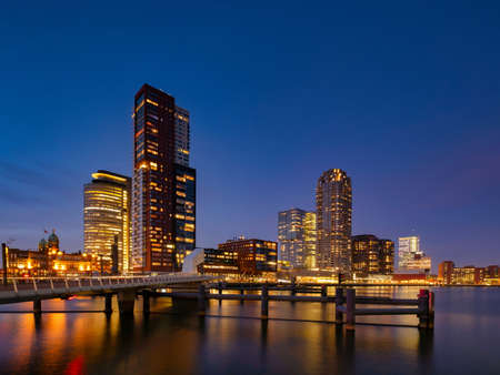 Rotterdam - 13 February 2019: Rotterdam, The Netherlands downtown skyline, several modern tall buildings on the waterfront at dusk in South Holland, Rotterdam,Netherlands