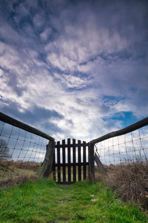 wide angle lens shot, a gate with left and right mesh. with impressive air Stok Fotoğraf