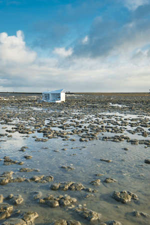 A container ship has lost a cargo at sea, off the coast of Friesland, the Netherlands. A freezer has washed ashore.  environmental pollution. Ecological problem.